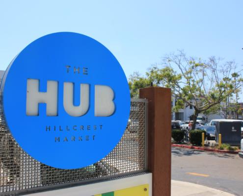 The hub branding on sign