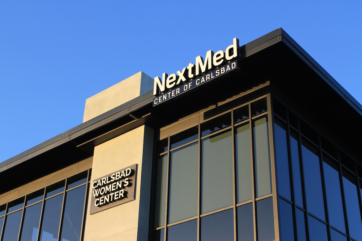 NextMed and Carlsbad women center branded sign