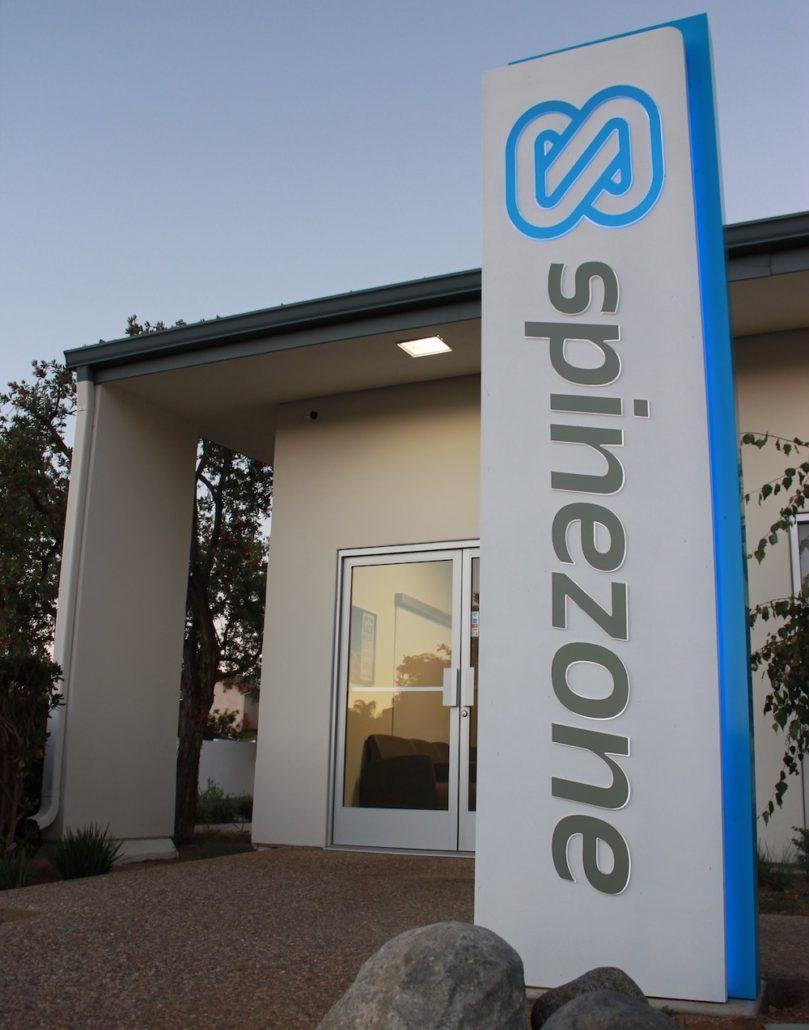 spinezone logo on outside pillar