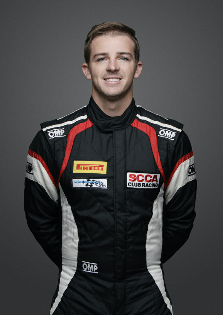 Medium Shot of Alex Kirby in a racing suit